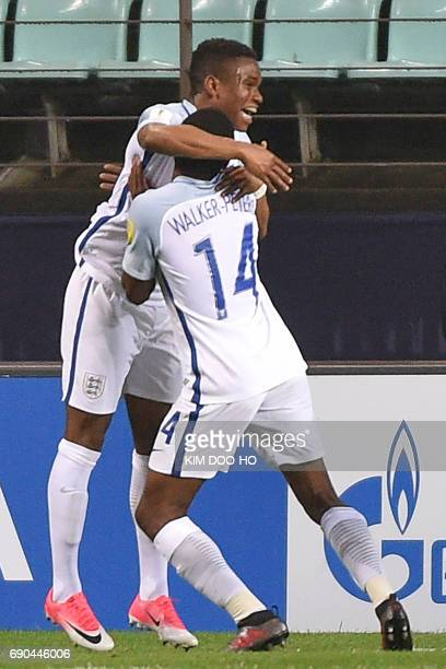 England's forward Ademola Lookman celebrates scoring with teammate Kyle WalkerPeters during their U20 World Cup round of 16 football match between...