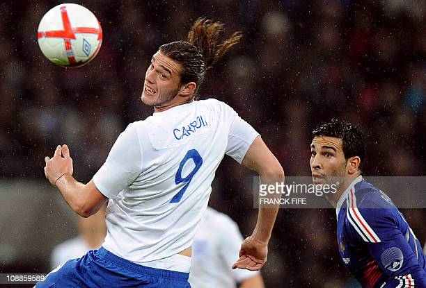 England's forward Andy Carrol vies with France's Adil Rami during their international friendly football match at Wembley Stadium in London on...