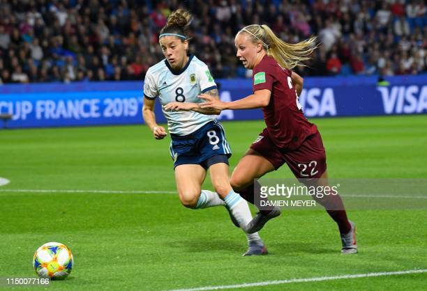 England's forward Beth Mead vies for the ball with Argentina's midfielder Ruth Bravo during the France 2019 Women's World Cup Group D football match...