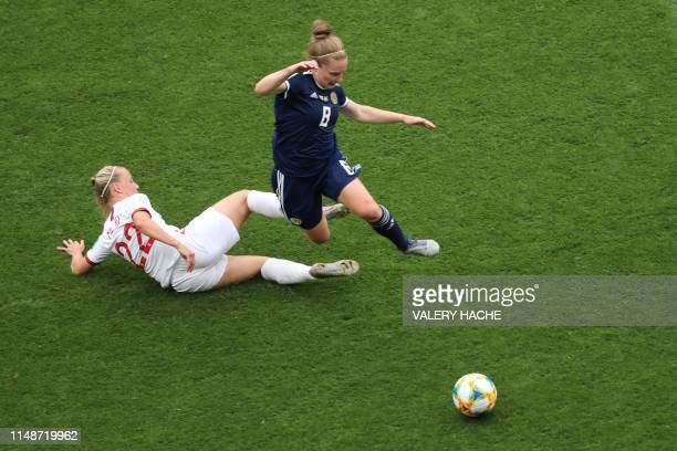 TOPSHOT England's forward Beth Mead vies for the ball with Scotland's midfielder Kim Little during the France 2019 Women's World Cup Group D football...