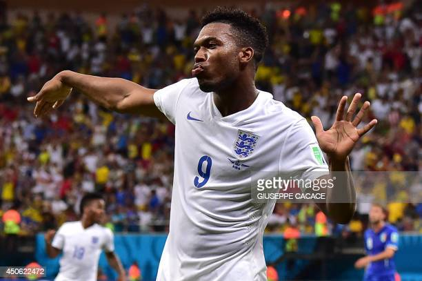 England's forward Daniel Sturridge celebrates after scoring a goal during a Group D football match between England and Italy at the Amazonia Arena in...