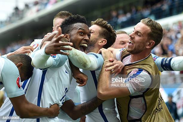 England's forward Daniel Sturridge celebrates scoring the 2-1 goal with team mates during the Euro 2016 group B football match between England and...