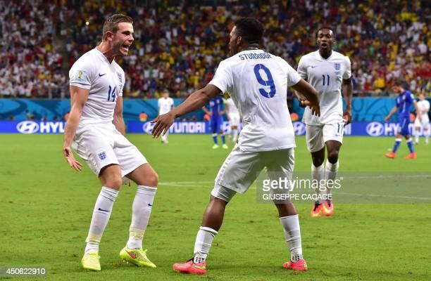 England's forward Daniel Sturridge celebrates with his temmate England's midfielder Jordan Henderson after scoring a goal during a Group D football...