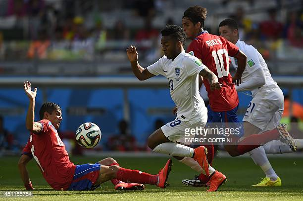 England's forward Daniel Sturridge is tackled by Costa Rica's defender Cristian Gamboa during the Group D football match between Costa Rica and...