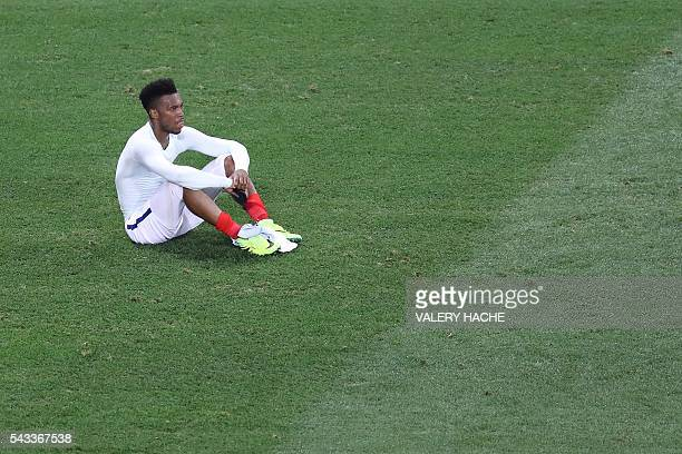 England's forward Daniel Sturridge reacts after the Euro 2016 round of 16 football match between England and Iceland at the Allianz Riviera stadium...