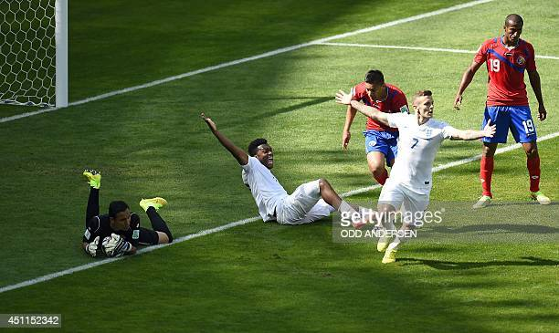 England's forward Daniel Sturridge sits on the pitch as he appeals with teammate England's midfielder Jack Wilshere as Costa Rica's defender Roy...