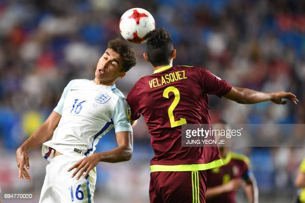 England's forward Dominic Calvert-Lewin and Venezuela's defender Williams Velasquez compete for the ball during the U-20 World Cup final football...