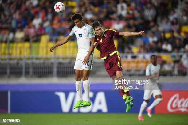 England's forward Dominic Calvert-Lewin and Venezuela's defender Nahuel Ferraresi compete for the ball during the U-20 World Cup final football match...