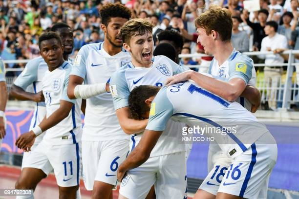 England's forward Dominic CalvertLewin celebrates his goal with teammates during the U20 World Cup final football match between England and Venezuela...