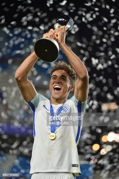 England's forward Dominic CalvertLewin celebrates with the trophy during the awards ceremony after winning the U20 World Cup final football match...