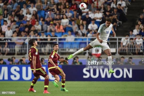 England's forward Dominic Calvert-Lewin heads the ball during the U-20 World Cup final football match between England and Venezuela in Suwon on June...