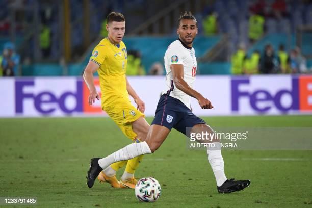 England's forward Dominic Calvert-Lewin is marked by Ukraine's defender Mykola Matviyenko during the UEFA EURO 2020 quarter-final football match...