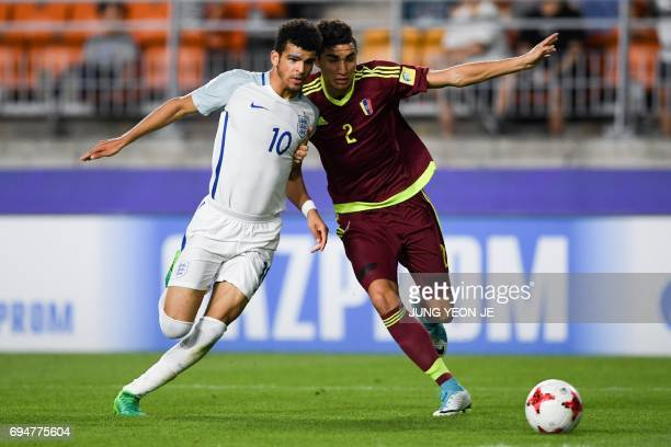 England's forward Dominic Solanke and Venezuela's defender Williams Velasquez compete for the ball during the U20 World Cup final football match...