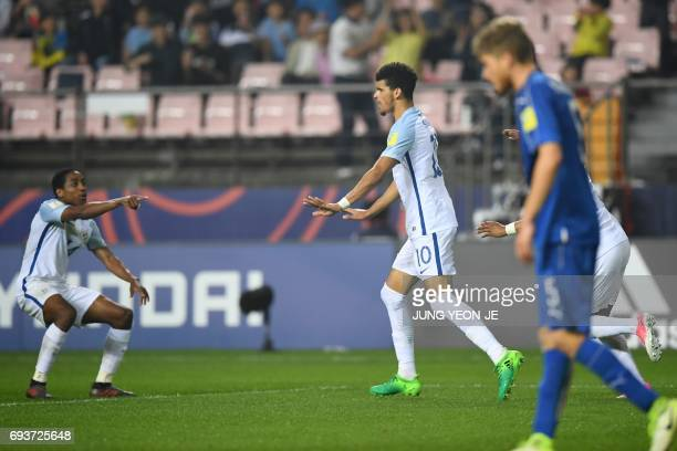England's forward Dominic Solanke celebrates his goal with defender Kyle WalkerPeters during the U20 World Cup semifinal football match between...