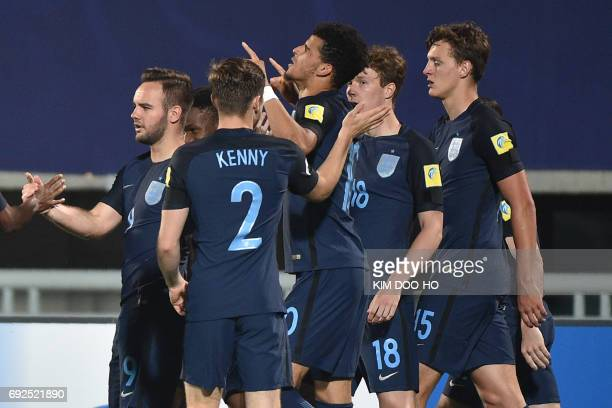 England's forward Dominic Solanke celebrates his goal with teammates during the U20 World Cup quarterfinal football match between England and Mexico...