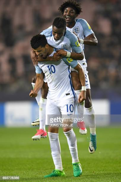 England's forward Dominic Solanke celebrates his goal with teammates during the U20 World Cup semifinal football match between England and Italy in...