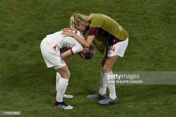 TOPSHOT England's forward Ellen White and England's defender Leah Williamson react at the end of the France 2019 Women's World Cup semifinal football...