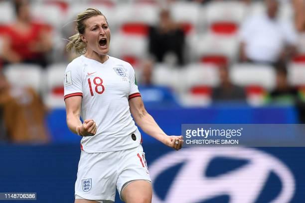 TOPSHOT England's forward Ellen White celebrates after scoring a goal during the France 2019 Women's World Cup Group D football match between England...