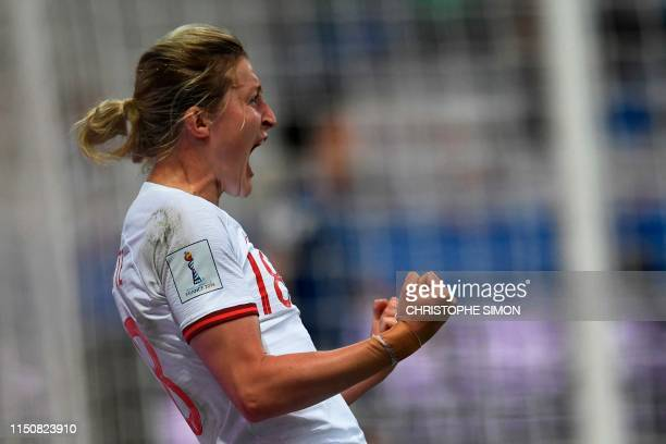 TOPSHOT England's forward Ellen White celebrates after scoring the opening goal during the France 2019 Women's World Cup Group D football match...