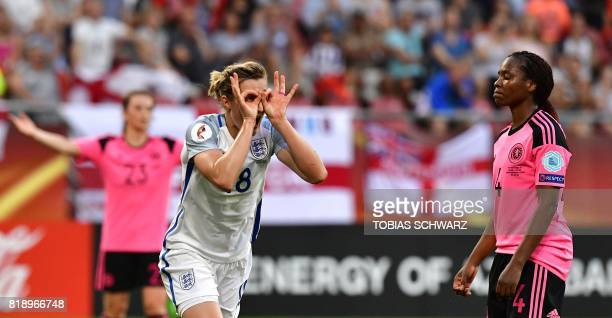 England's forward Ellen White celebrates past Scotland's defender Ifeoma Dieke after scoring a goal during the UEFA Women's Euro 2017 football match...