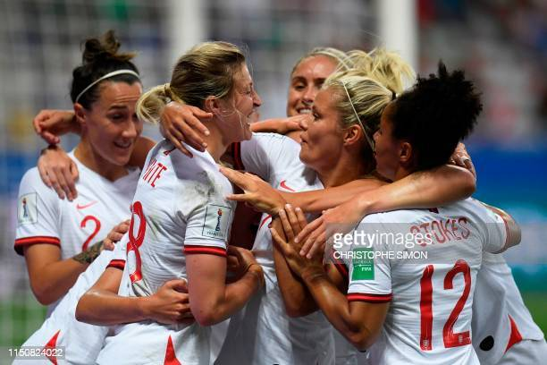 England's forward Ellen White celebrates with teammates aferafter scoring the opening goal during the France 2019 Women's World Cup Group D football...