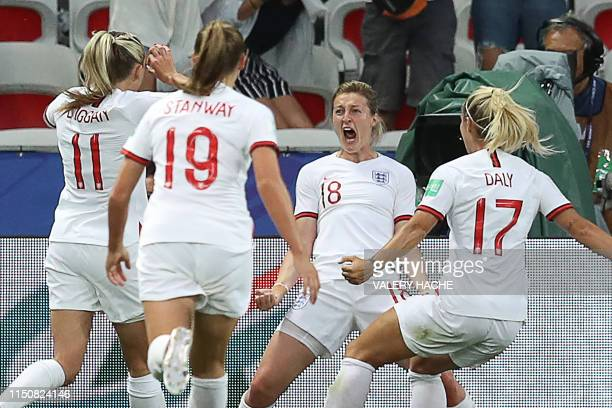 TOPSHOT England's forward Ellen White celebrates with teammates after scoring a goal during the France 2019 Women's World Cup Group D football match...