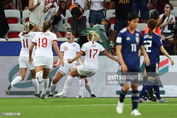 England's forward Ellen White celebrates with teammates after scoring a goal during the France 2019 Women's World Cup Group D football match between...