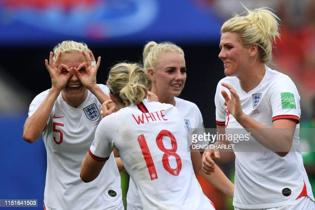 England's forward Ellen White is congratulated by teammates after scoring a goal during the France 2019 Women's World Cup round of sixteen football...