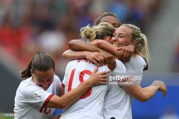 TOPSHOT England's forward Ellen White is congratulated by teammates after scoring a goal during the France 2019 Women's World Cup round of sixteen...