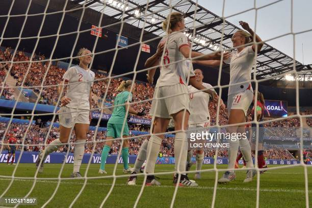England's forward Ellen White is congratulated by teammates after scoring a goal during the France 2019 Women's World Cup quarterfinal football match...