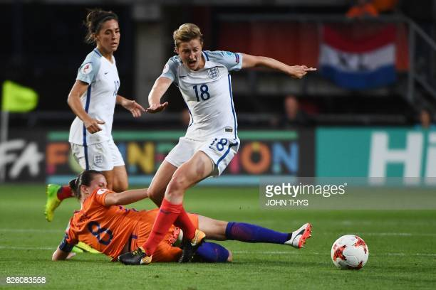 England's forward Ellen White is tackled by Netherlands' midfielder Sherida Spitse during the UEFA Womens Euro 2017 football tournament semifinal...