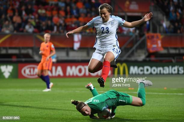 England's forward Francesca Kirby jumps over Netherlands' goalkeeper Sari van Veenendaal during the UEFA Womens Euro 2017 football tournament...