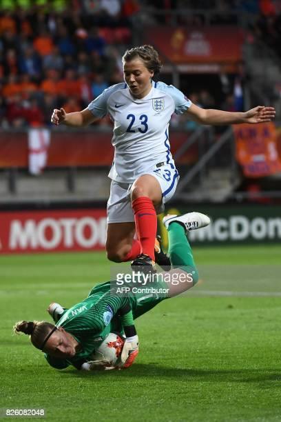 England's forward Francesca Kirby jumps over Netherlands' goalkeeper Sari van Veenendaal during the UEFA Womens Euro 2017 football tournament...