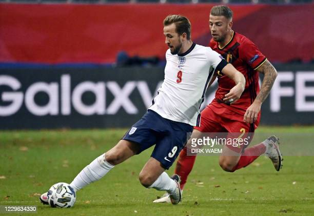 England's forward Harry Kane and Belgium's Toby Alderweireld fight for the ball during the UEFA Nations League football match between Belgium and...