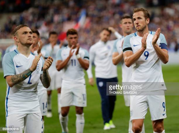 England's forward Harry Kane and defender Kieron Trippier applaud their supporters after the international friendly football match between France and...