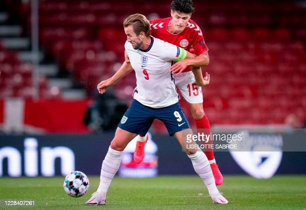 England's forward Harry Kane and Denmark's midfielder Christian Norgaard vie for the ball during the UEFA Nations League football match between...