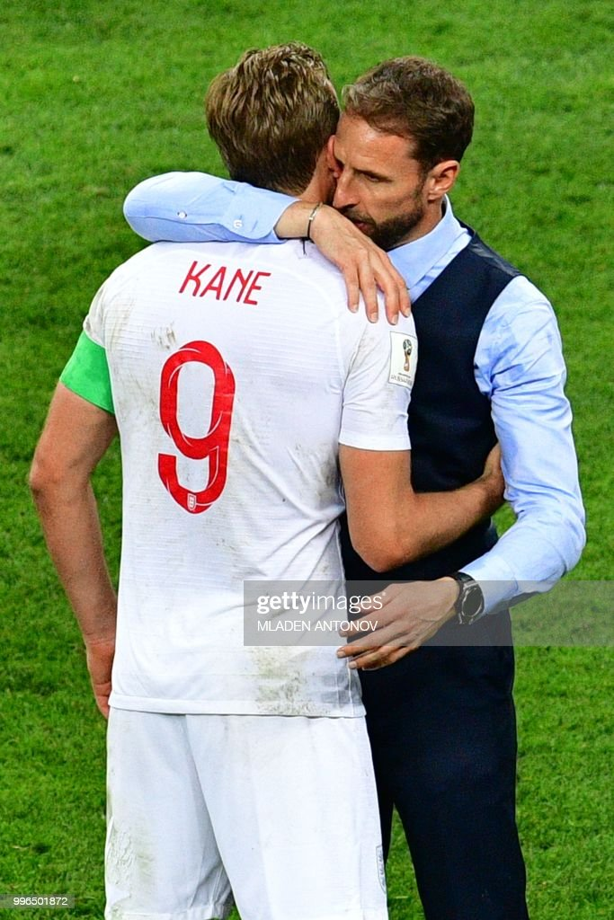England's forward Harry Kane (L) and England's coach Gareth Southgate react after losing the Russia 2018 World Cup semi-final football match between Croatia and England at the Luzhniki Stadium in Moscow on July 11, 2018. (Photo by Mladen ANTONOV / AFP) / RESTRICTED