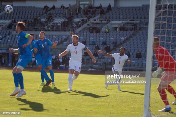 England's forward Harry Kane and England's forward Raheem Sterling eye the ball during a cross during the UEFA Nations League football match between...