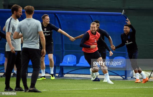 England's forward Harry Kane and teammates take part in a training session at Stadium Spartak Zelenogorsk Saint Petersburg on June 17 2018 on the eve...