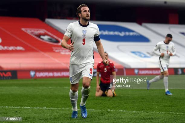 England's forward Harry Kane celebrates after scoring a goal during the FIFA World Cup Qatar 2022 qualification Group I football match between...