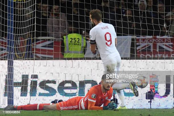 England's forward Harry Kane celebrates after scoring a goal next to Kosovo's goalkeeper Arijanet Muric during the UEFA Euro 2020 qualifying Group A...