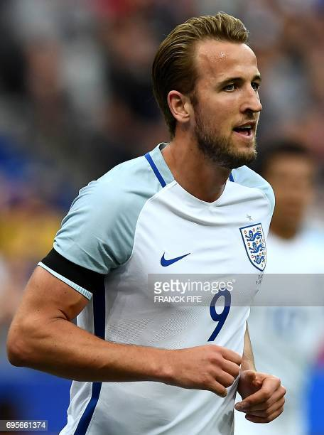 England's forward Harry Kane celebrates after scoring during the international friendly football match between France and England at The Stade de...