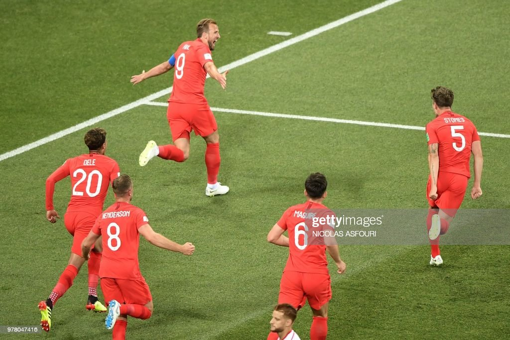TOPSHOT - England's forward Harry Kane (up) celebrates after scoring his first goal during the Russia 2018 World Cup Group G football match between Tunisia and England at the Volgograd Arena in Volgograd on June 18, 2018. (Photo by NICOLAS ASFOURI / AFP) / RESTRICTED