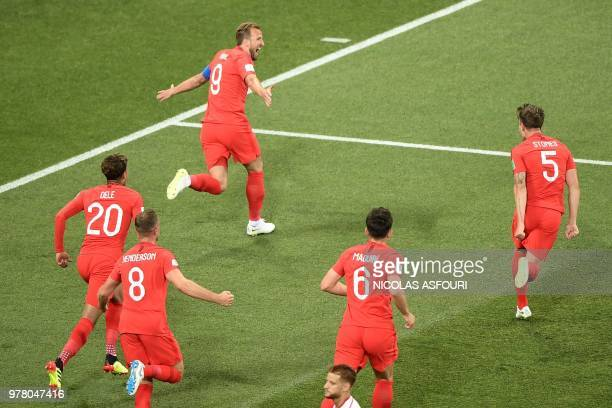 TOPSHOT England's forward Harry Kane celebrates after scoring his first goal during the Russia 2018 World Cup Group G football match between Tunisia...