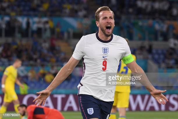 England's forward Harry Kane celebrates after scoring the first goal during the UEFA EURO 2020 quarter-final football match between Ukraine and...