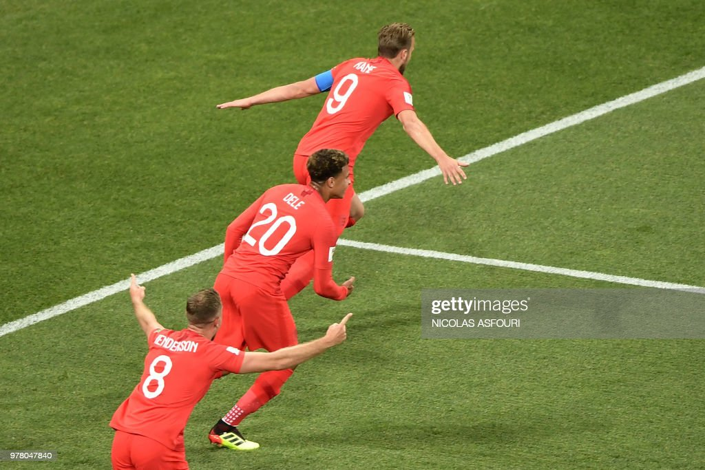 England's forward Harry Kane (up) celebrates after scoring the opening goal during the Russia 2018 World Cup Group G football match between Tunisia and England at the Volgograd Arena in Volgograd on June 18, 2018. (Photo by NICOLAS ASFOURI / AFP) / RESTRICTED