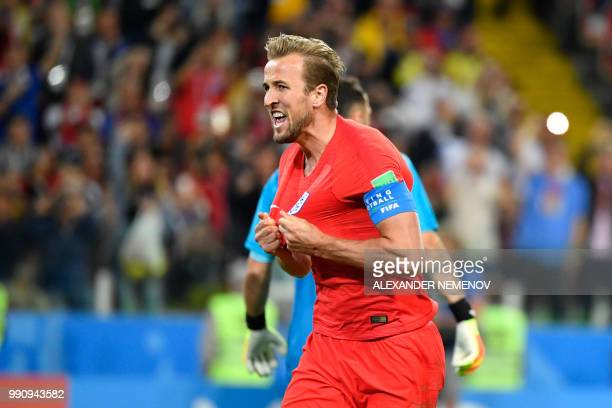 England's forward Harry Kane celebrates after scoring the opening goal from the penalty spot during the Russia 2018 World Cup round of 16 football...