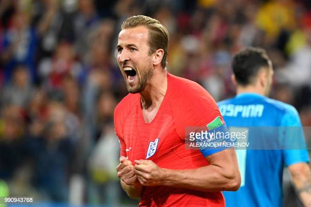 TOPSHOT England's forward Harry Kane celebrates after scoring the opening goal from the penalty spot during the Russia 2018 World Cup round of 16...
