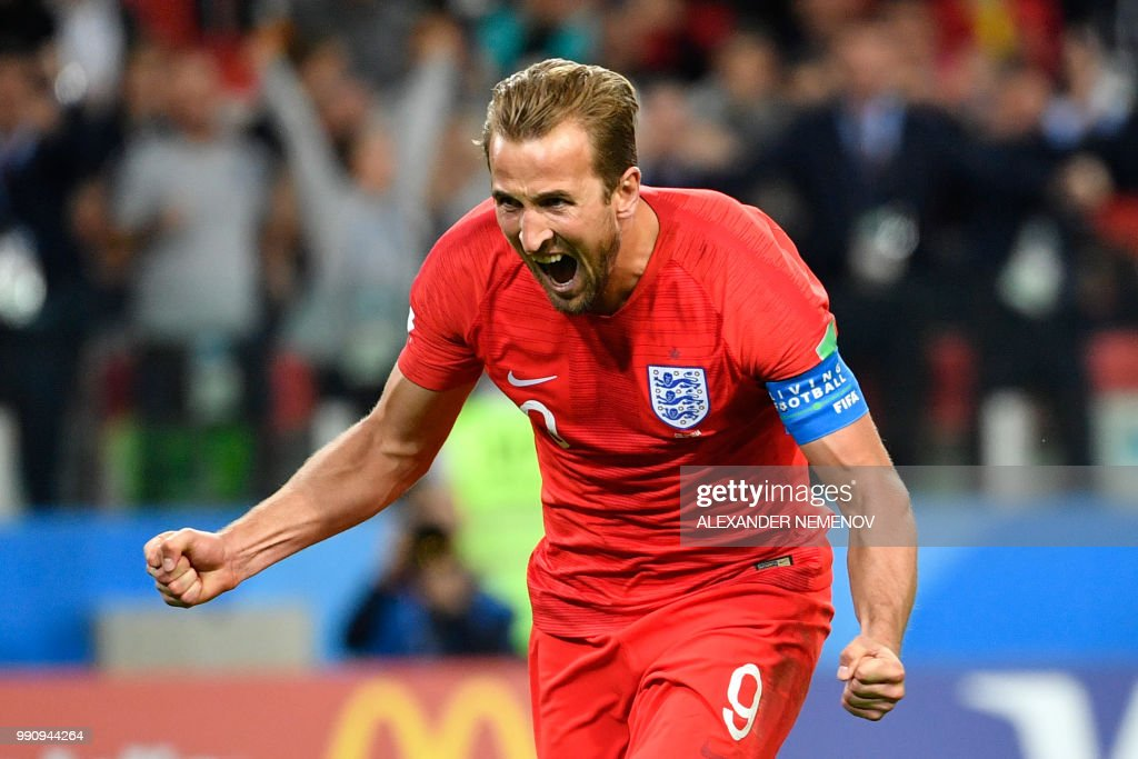 TOPSHOT - England's forward Harry Kane celebrates after scoring the opening goal from the penalty spot during the Russia 2018 World Cup round of 16 football match between Colombia and England at the Spartak Stadium in Moscow on July 3, 2018. (Photo by Alexander NEMENOV / AFP) / RESTRICTED