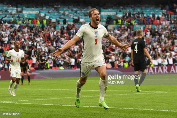 England's forward Harry Kane celebrates after scoring the second goal during the UEFA EURO 2020 round of 16 football match between England and...